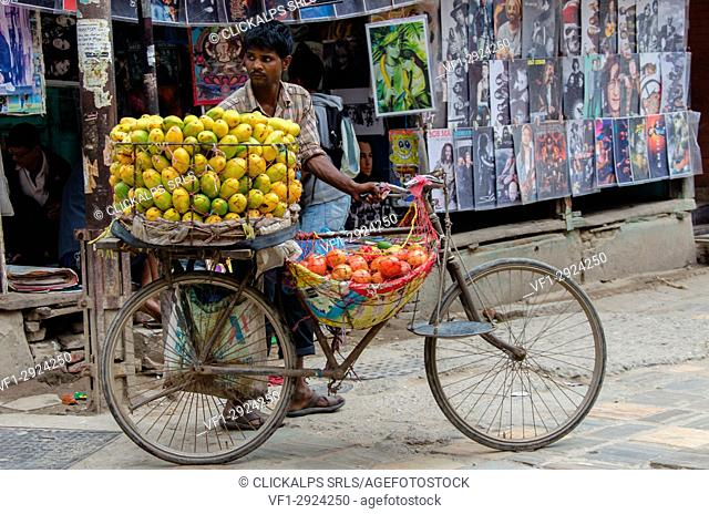A fruit seller and his bicycle shop in the streets of Thamel, downtown Kathmandu, Nepal, Asia