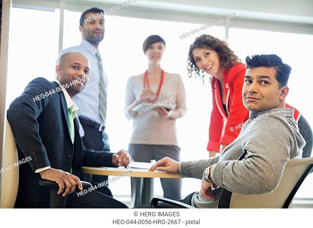 Business people looking away during meeting at table in office