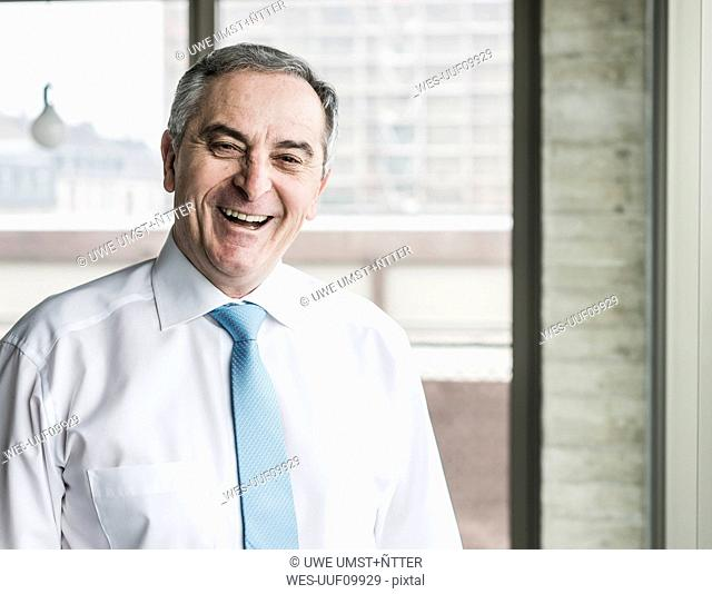 Portrait of a senior manager, laughing