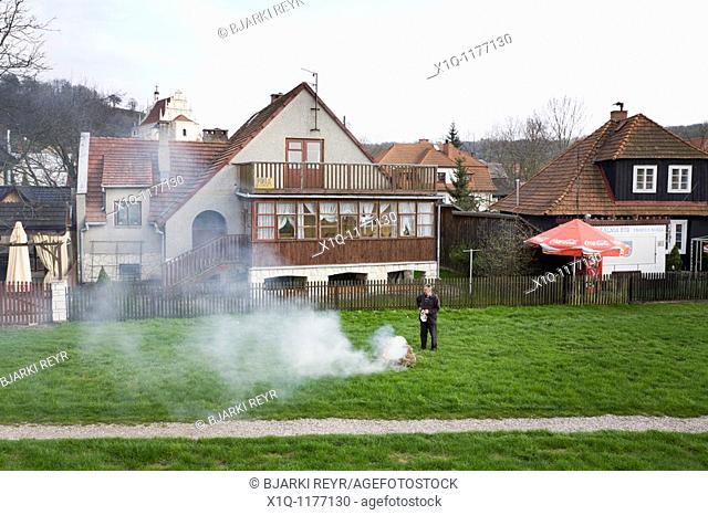 Man burning hay  Kazimierz Dolny Poland