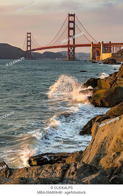 Golden Gate Bridge at sunset shot from Baker Beach. San Francisco, Marin County, California, USA