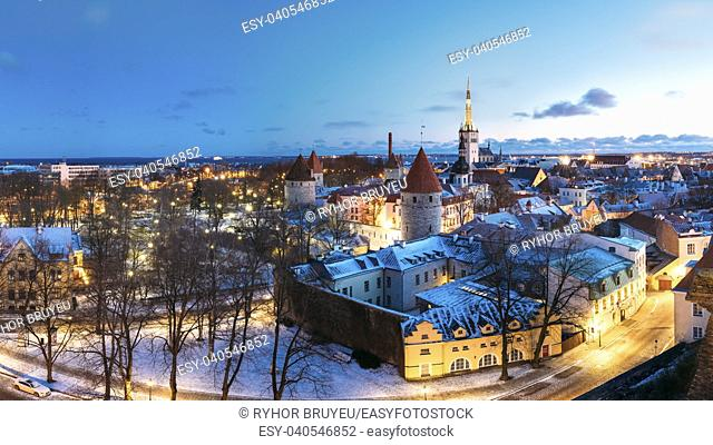 Tallinn, Estonia. Panorama Of Old Part Of Traditional Medieval Houses, Old Narrow Streets And Ancient Towers With Fortification Walls In Evening
