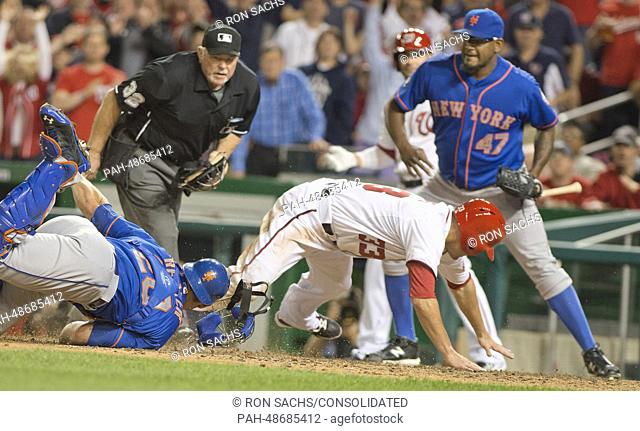 New York Mets catcher Anthony Recker (20) tags Washington Nationals Pinch-hitter Greg Dobbs (33) out at home in the seventh inning during the game at Nationals...