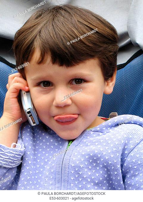 3-year-old girl talking on cel phone