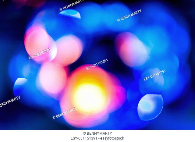 Background with bokeh defocused lights in orange blue colors from disco mirror ball
