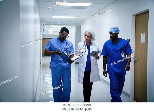 Doctor and nurses discussing paperwork in hospital