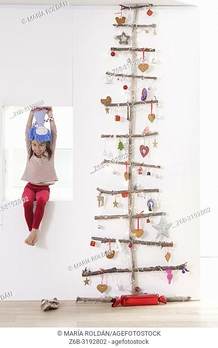 Modern Christmas tree and little girl