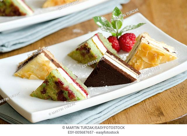 Selection of mini dessert sandwiches with raspberries and mint