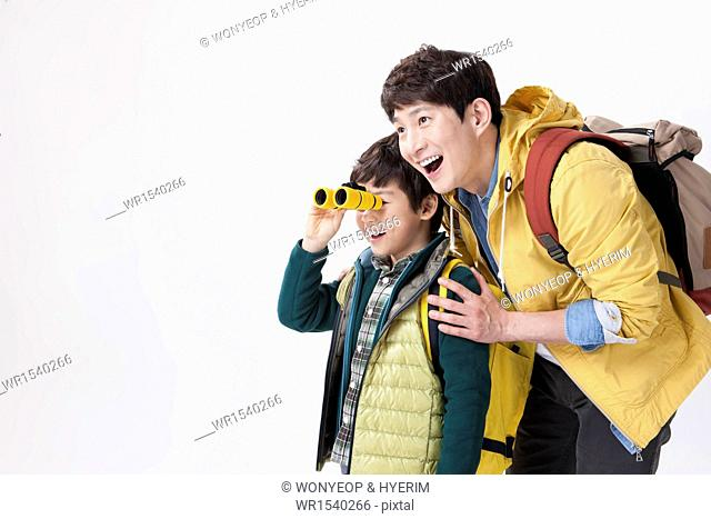 a father and a son looking with binoculars