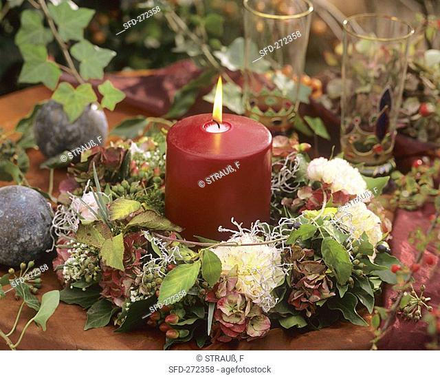 Table wreath of carnations, hydrangeas with candle