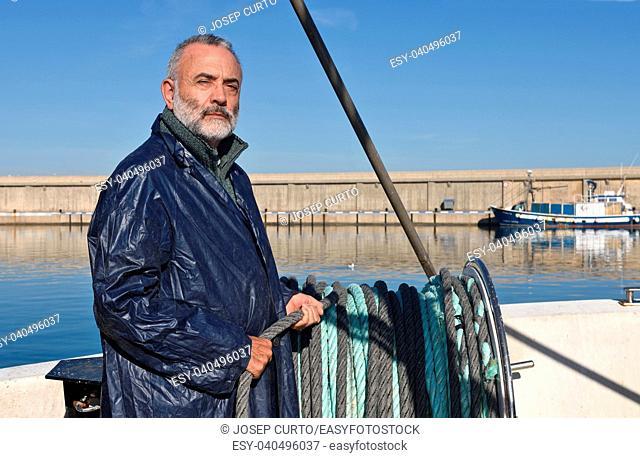 fisherman in the fishing port of Escala, Costa Brava, Girona province, Spain