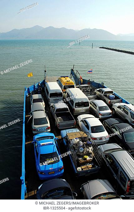Cars on a ferry boat between Trat mainland and Koh Chang Island, National Park Mu Ko Chang, Trat, Gulf of Thailand, Thailand, Asia