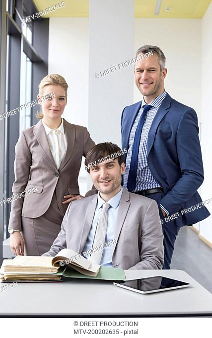 Portrait of colleagues in office, smiling