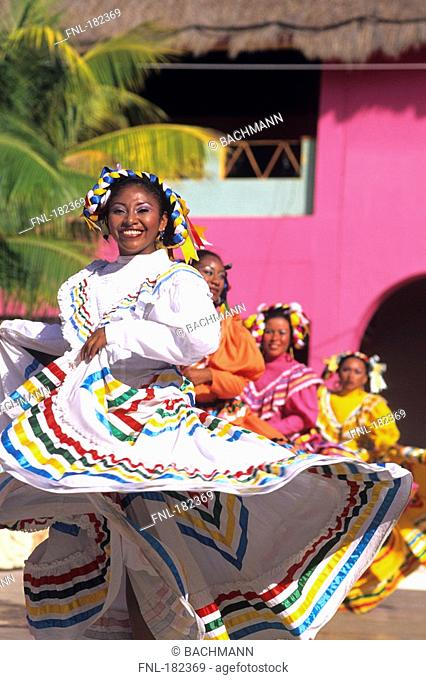 Group of female traditional latin dancers smiling, Costa Maya, Cozumel, Quintana Roo, Mexico