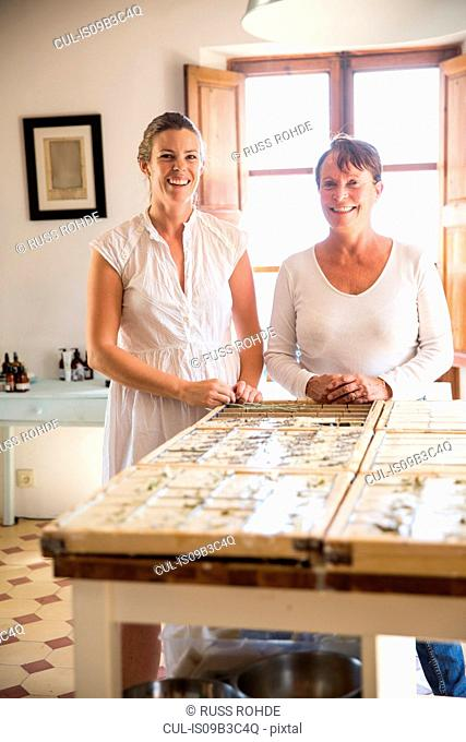 Portrait of two women in handmade soap workshop