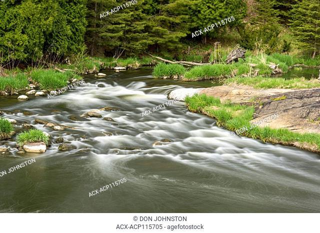 Fast flowing water of Junction Creek in spring, Greater Sudbury, Ontario, Canada