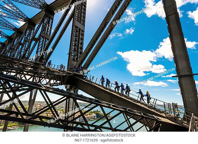 People climbing to the top of the Sydney Harbour Bridge to see the unparalled view of Sydney and it's harbor, BridgeClimb Sydney, Sydney, New South Wales