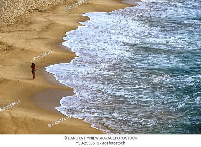 Europe, Portugal, Southern Portugal , Algarve region , Faro district , Lagos, single woman walking at the seaside, Praia Batata - Batata beach