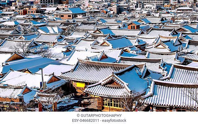 Roof of Jeonju traditional Korean village covered with snow, Jeonju Hanok village in winter, South Korea