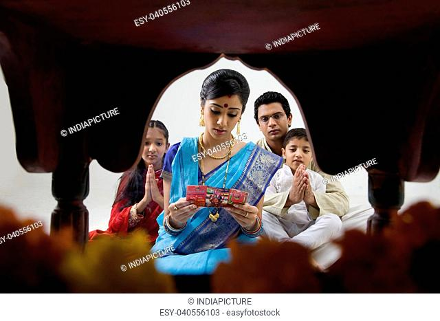 Bengali family performing a puja