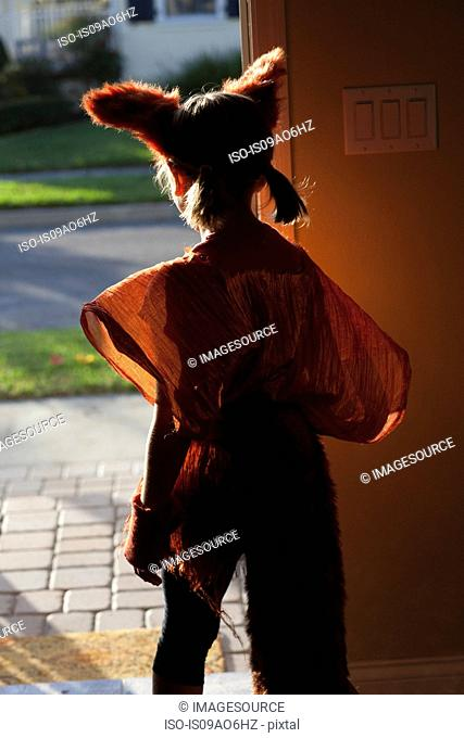 Girl leaving house for trick or treating