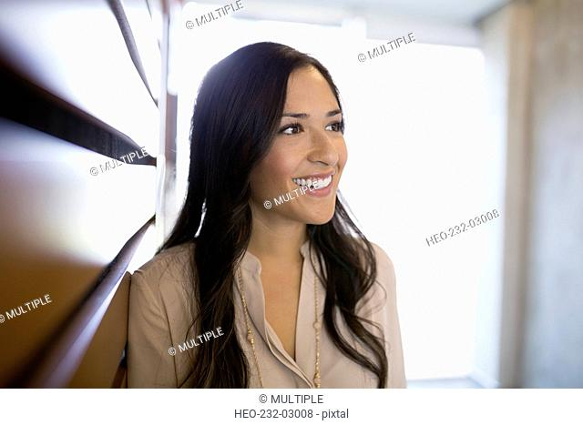 Smiling brunette businesswoman looking away