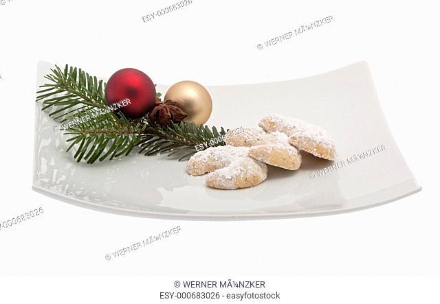 Vanillekipferl mit Weihnachtsdekoration