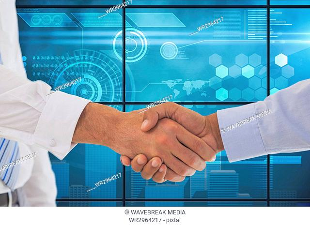 Businessman shaking their hands with a blue digital background
