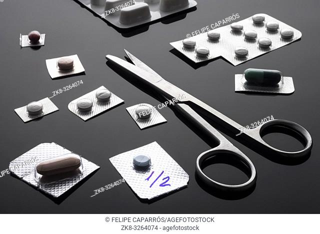 Monodose medication pills with scissors, conceptual image, horizontal composition