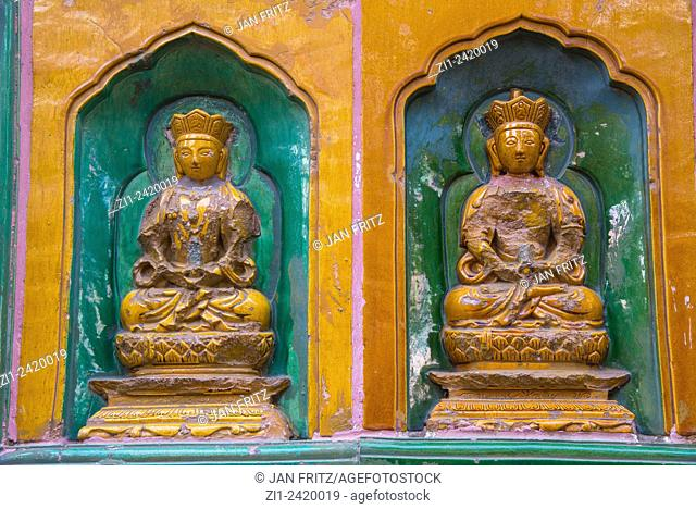 two small buddhists statues at temple at summer palace in beijing china