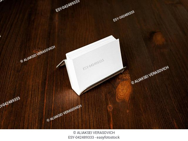 Photo of blank business cards on a metal card holder. Placing your design