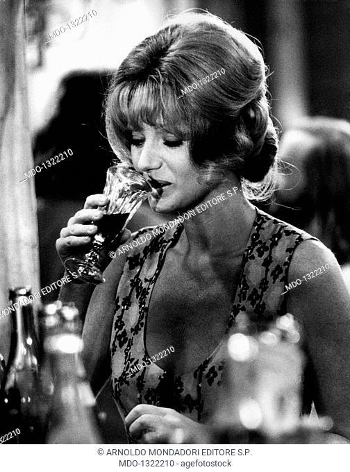 Sylva Koscina in Paris. Croatian-born Italian actress Sylva Koscina drinking from a glass. Paris, 1970