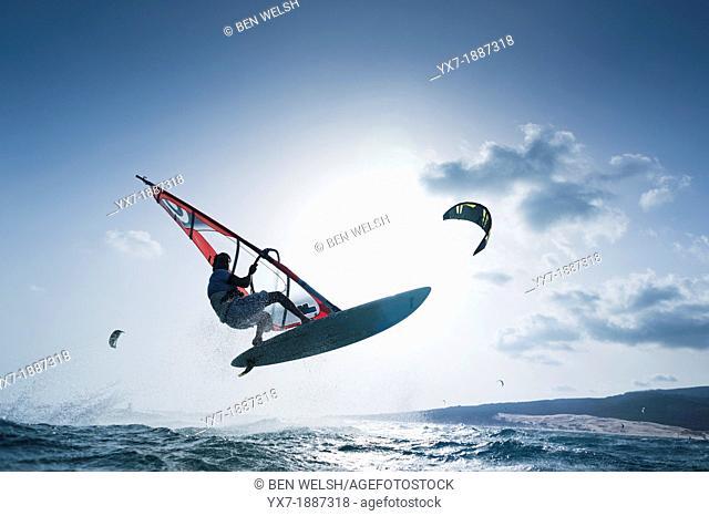 Windsurfer jumping. Tarifa, Costa de la Luz, Cadiz, Andalusia, Spain, Europe