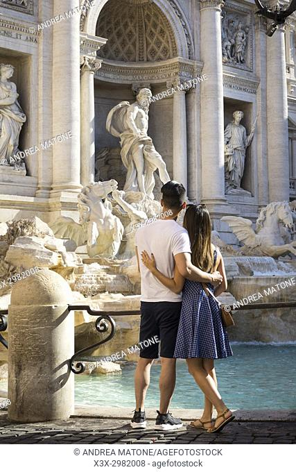 Couple at the Trevi fountain in Rome Italy