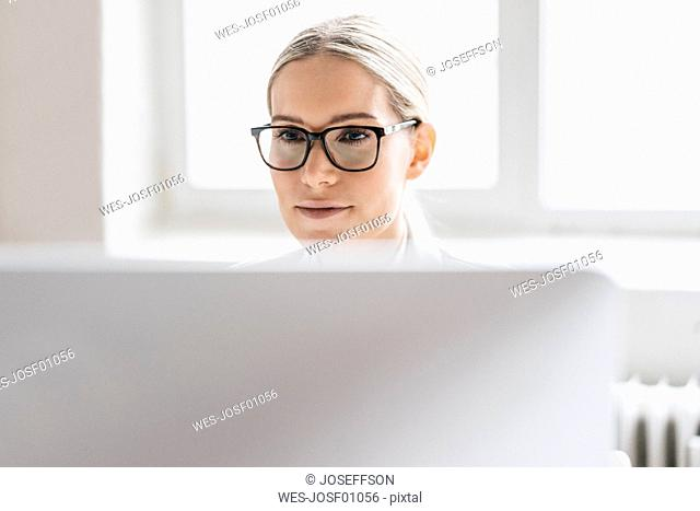 Portrait of businesswoman working with computer