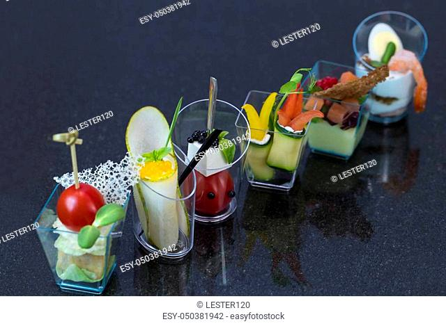 Molecular cuisine dishes in plastic buffet tableware
