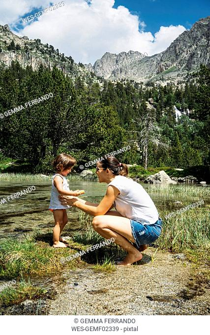 Spain, Mother and toddler exploring lakes in the Pyrenees