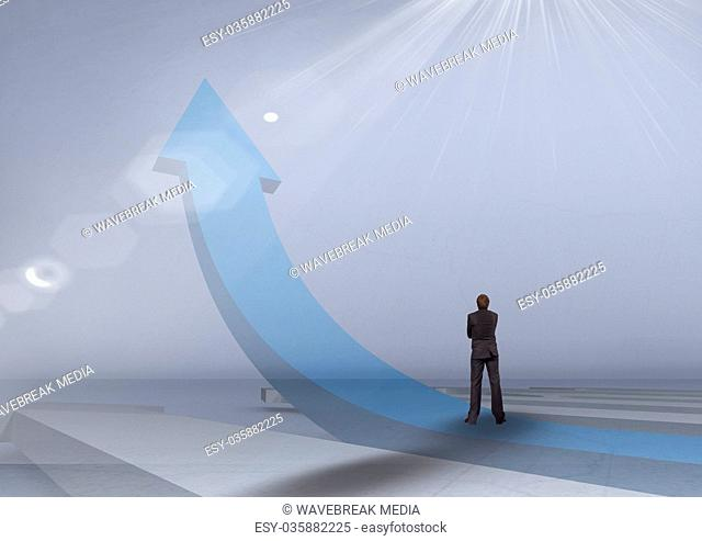businessman on blue arrow