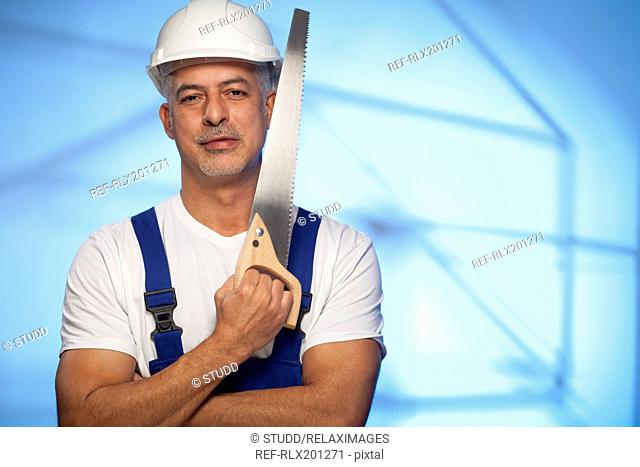 Workman construction worker holding wood handsaw