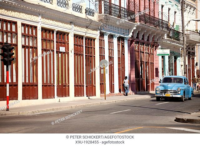 typical street and classic US car in Cienfuegos, Cuba, Caribbean