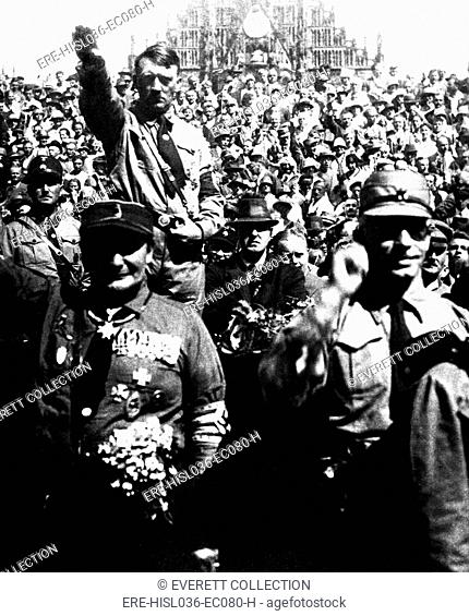 Hitler at Nazi Party rally, Nuremberg, Germany, ca. 1928. Herman Goering is in left foreground. Photo by Heinrich Hoffman. (BSLOC-2013-9-161)