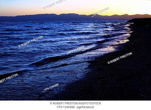 Kyrgyzstan - Lake Song Kul - sunset over the mountains surrounding Lake Song Kul