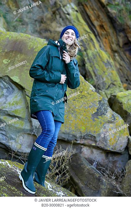 Adult woman at the coast of Santa Clara Island, Donostia, San Sebastian, Gipuzkoa, Basque Country, Spain, Europe, Raincoat, Winter