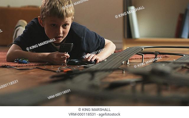 CU TU Boy 10-11 playing with electric slot cars / Orem, Utah, USA