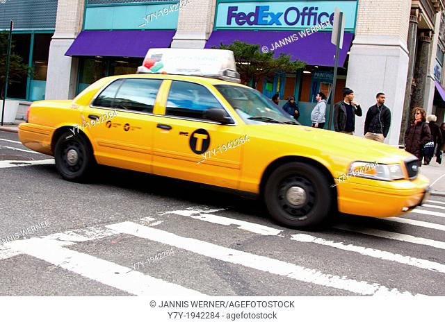 Famous yellow cab in the streets of Manhattan, New York, NY, USA