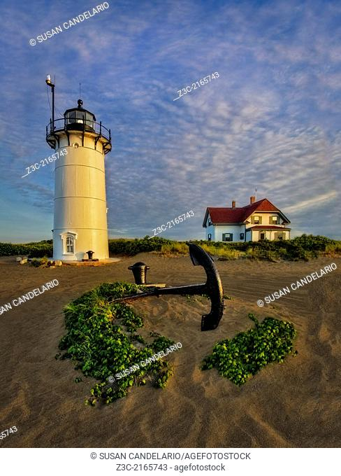 Race Point Lighthouse with the lighthouse kepers home in the background during the last hour before sunset in Provincetown, Cape Cod, Massachusetts, USA