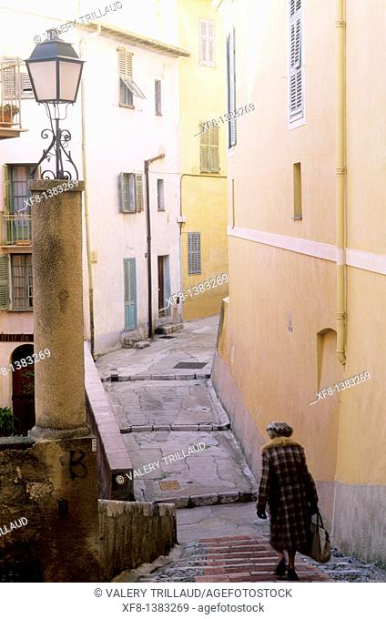 Narrow street in the old city of Menton, Alpes-Maritimes, Provence-Alpes-Côte d'Azur, France