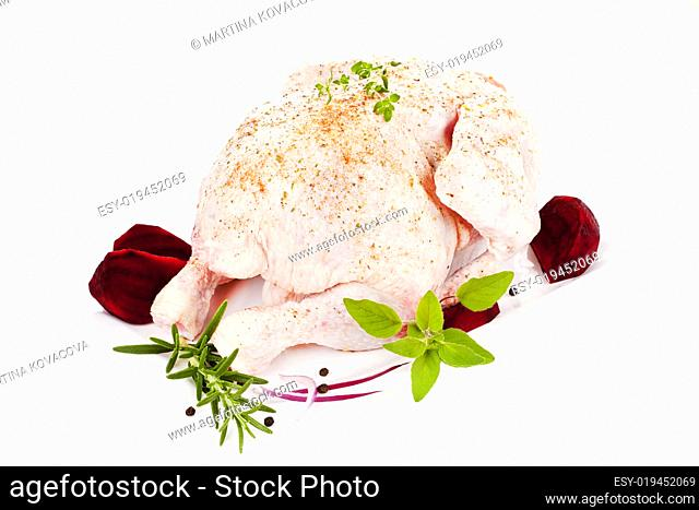 Raw whole chicken. Poultry