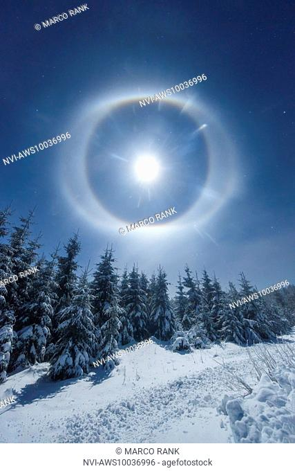 Moon halo (22 degree ring, circumscribed halo) on diamond dust above the mountain Klínovec, district of Carlsbad, Czech Republic
