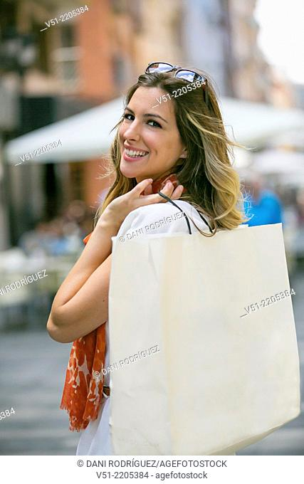 Pretty blonde woman happy with her shopping bag